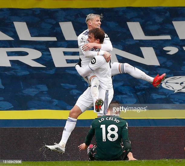 Patrick Bamford of Leeds United celebrates with Ezgjan Alioski after scoring their side's second goal as Giovani Lo Celso of Tottenham Hotspur looks...