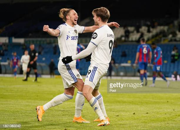 Patrick Bamford of Leeds United celebrates with Luke Ayling after scoring their team's second goal during the Premier League match between Leeds...