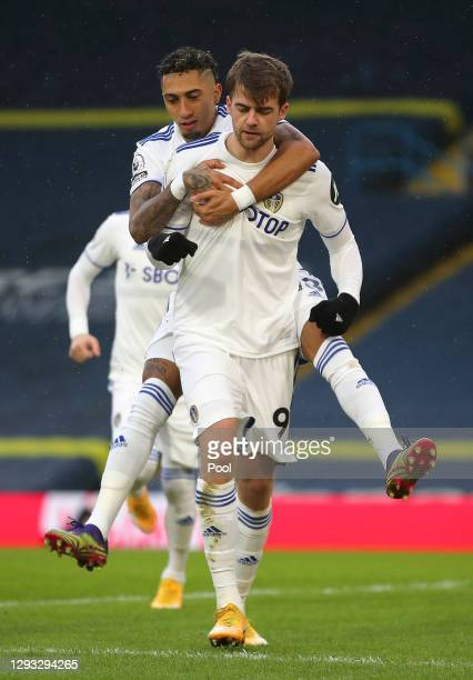Patrick Bamford of Leeds United celebrates with Raphinha after scoring their team's first goal from a penalty during the Premier League match between...
