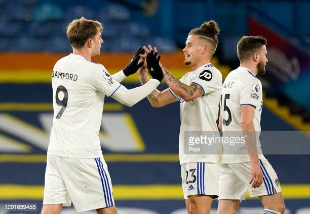 Patrick Bamford of Leeds United celebrates with teammate Kalvin Phillips after scoring their team's first goal during the Premier League match...