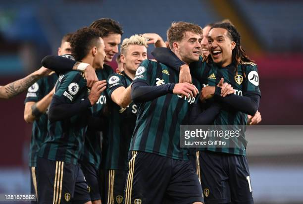 Patrick Bamford of Leeds United celebrates with teammates after scoring his team's second goal during the Premier League match between Aston Villa...