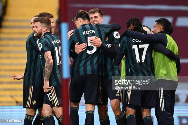 Patrick Bamford of Leeds United celebrates with teammates after scoring his team's third goal during the Premier League match between Aston Villa and...