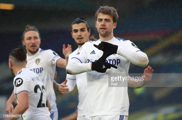 Patrick Bamford of Leeds United celebrates with teammates after scoring their team's first goal from a penalty during the Premier League match...