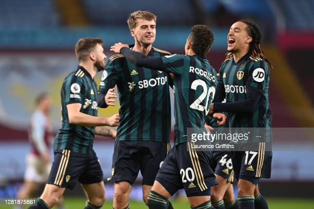 Patrick Bamford of Leeds United celebrates with teammates Rodrigo Moreno and Helder Costa of Leeds United after scoring their team's second goal...