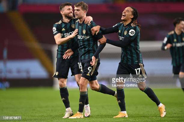 Patrick Bamford of Leeds United celebrates with teammates Stuart Dallas and Helder Costa of Leeds United after scoring their team's second goal...