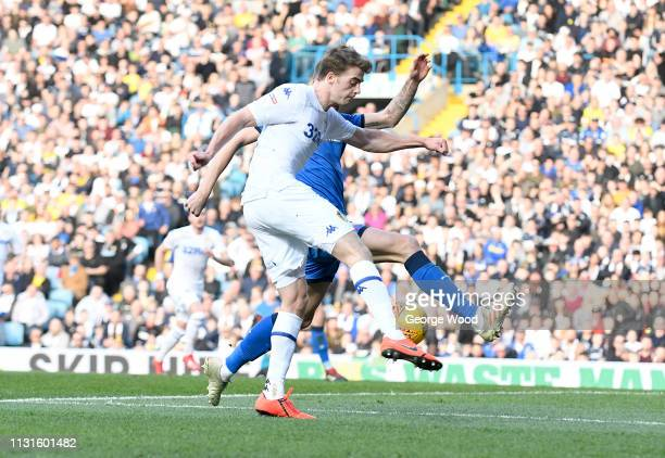 Patrick Bamford of Leeds United gets in a cross under pressure from Mark Beevers of Bolton Wanderers during the Sky Bet Championship match between...