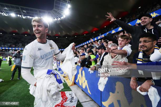 Patrick Bamford of Leeds United gives jerseys to fans after the match between the Western Sydney Wanderers and Leeds United at Bankwest Stadium on...