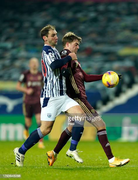 Patrick Bamford of Leeds United holds off Branislav Ivanovic of West Bromwich Albion during the Premier League match between West Bromwich Albion and...