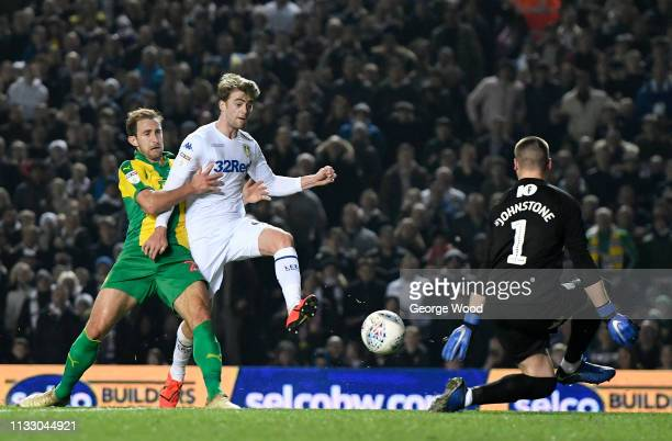 Patrick Bamford of Leeds United holds off challenge by Craig Dawson of West Bromwich Albion to score his sides second goal past goalkeeper Sam...
