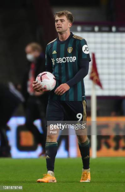 Patrick Bamford of Leeds United holds the match ball following his sides victory in the Premier League match between Aston Villa and Leeds United at...