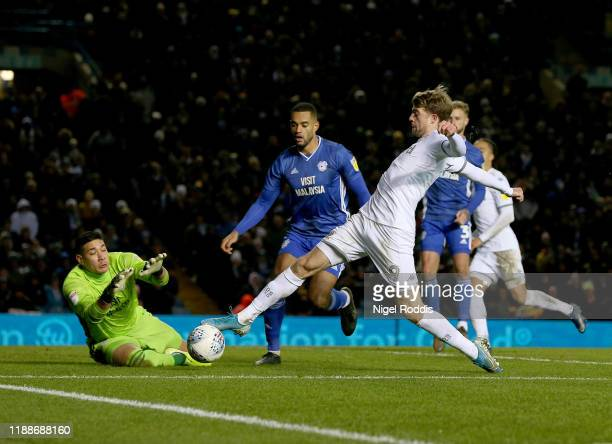 Patrick Bamford of Leeds United is fouled for a penalty by Neil Etheridge of Cardiff City during the Sky Bet Championship match between Leeds United...