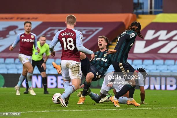 Patrick Bamford of Leeds United is fouled near the area by Tyrone Mings of Aston Villa during the Premier League match between Aston Villa and Leeds...