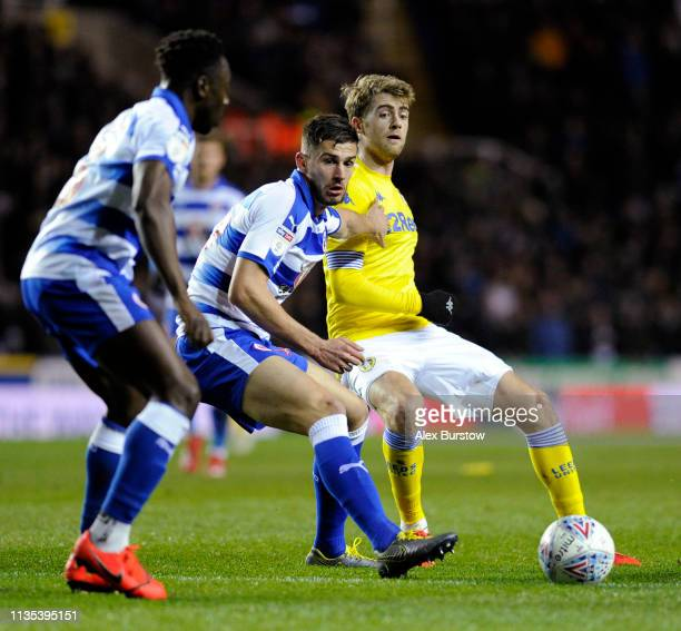 Patrick Bamford of Leeds United passes the ball under pressure from Matt Miazga of Reading during the Sky Bet Championship match between Reading and...