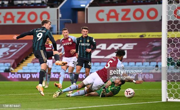 Patrick Bamford of Leeds United scores his team's first goal during the Premier League match between Aston Villa and Leeds United at Villa Park on...