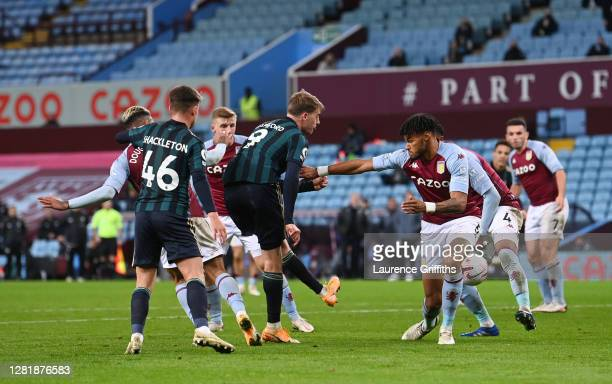 Patrick Bamford of Leeds United scores his team's third goal during the Premier League match between Aston Villa and Leeds United at Villa Park on...
