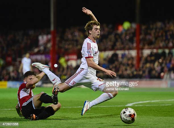 Patrick Bamford of Middlesbrough is challenged by Harlee Dean of Brentford during the Sky Bet Championship Playoff semifinal first leg match between...