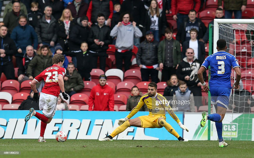 Patrick Bamford of Middlesbrough rounds Bartosz Bialkowski of Ipswich Town before scoring his side's third goal during the Sky Bet Championship match between Middlesbrough and Ipswich Town at the Riverside Stadium on March 14, 2015 in Middlesbrough, England.