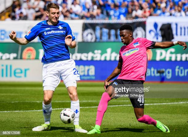 Patrick Banggaard of Darmstadt challenges Jordan Torunarigha of Hertha BSC during the Bundesliga match between SV Darmstadt 98 and Hertha BSC at...
