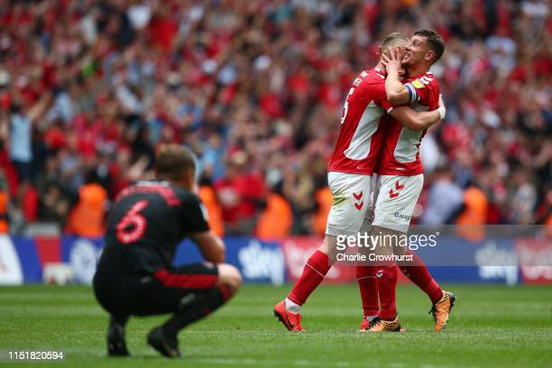 Patrick Bauer and Jason Pearce of Charlton Athletic celebrate victory at the finals whistle during the Sky Bet League One Playoff Final match between...
