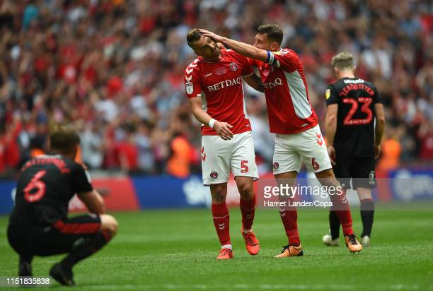 Patrick Bauer of Charlton Athletic and Jason Pearce of Charlton Athletic celebrate following their team's victory in the Sky Bet League One Playoff...