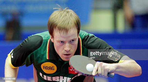 Patrick Baum of Germany plays against Panagiotis Gionis of Greece during the final of the mens team event at the Table Tennis European championship...
