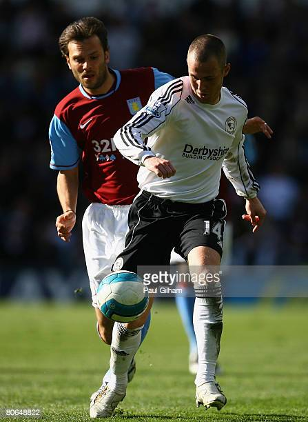 Patrick Berger of Aston Villa battles for the ball with Kenny Miller of Derby County during the Barclays Premier League match between Derby County...