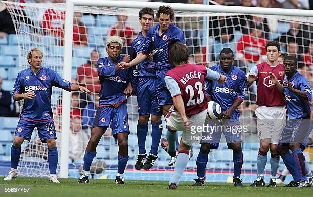 Patrick Berger of Aston Villa has a shot on goal during the Barclays Premiership match between Aston Villa and Middlesbrough at Villa Park on October...