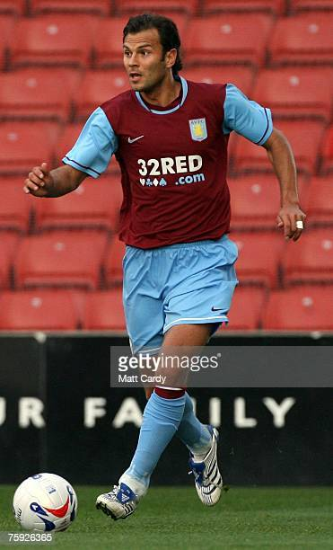 Patrick Berger of Aston Villa looks to pass the ball during the pre season friendly match between Stoke and Aston Villa at the Britannia Stadium on...