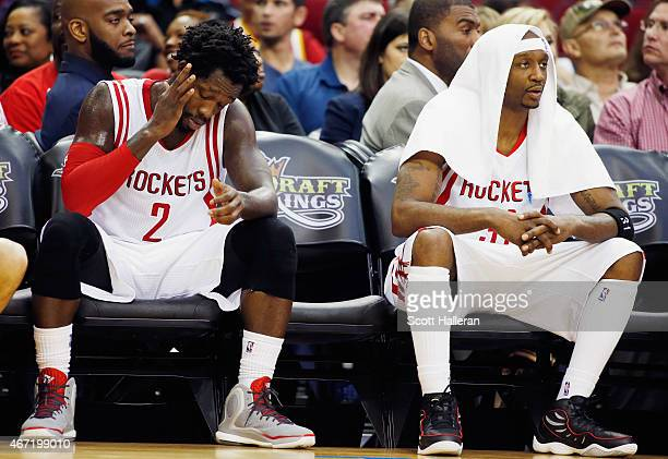 Patrick Beverley and Jason Terry of the Houston Rockets wait on the bench late in their game against the Phoenix Suns at the Toyota Center on March...