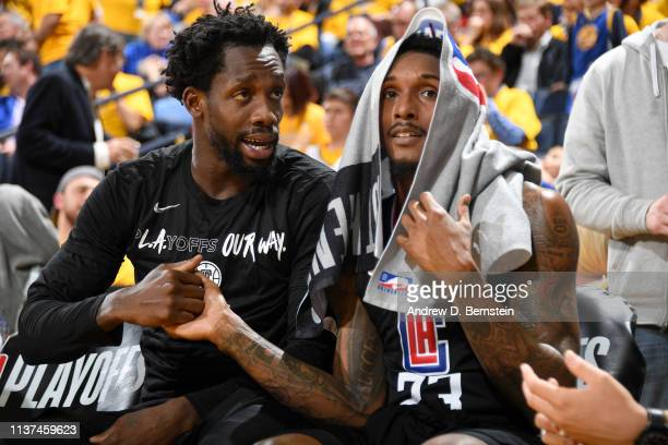 Patrick Beverley and Lou Williams of the LA Clippers shake hands in Game Two of Round One against the Golden State Warriors during the 2019 NBA...