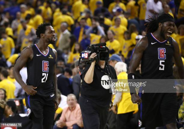 Patrick Beverley and Montrezl Harrell of the LA Clippers celebrate after they beat the Golden State Warriors during Game Two of the first round of...