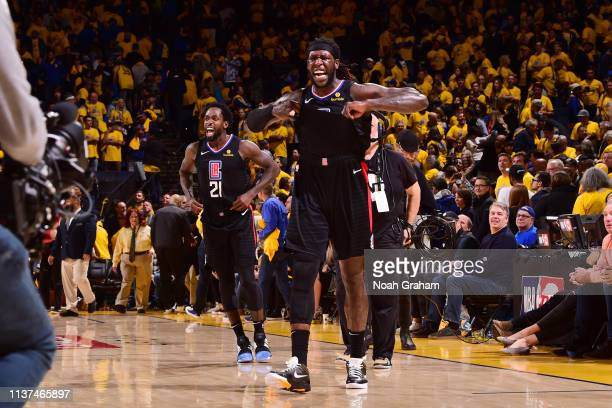 Patrick Beverley and Montrezl Harrell of the LA Clippers react during a game against the Golden State Warriors during Game Two of Round One of the...