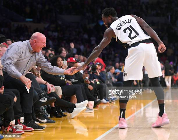 Patrick Beverley gets a high five from Los Angeles Clippers owner Steve Balmer during the game against the Los Angeles Lakers at Staples Center on...