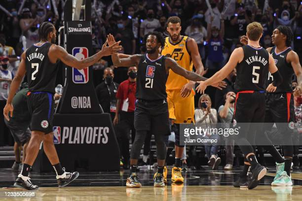 Patrick Beverley hi-fives Kawhi Leonard and Luke Kennard of the LA Clippers during Round 2, Game 4 of the 2021 NBA Playoffs on June 14, 2021 at...