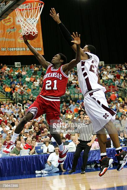 Patrick Beverley of the Arkansas Razorbacks is blocked from behind by Charles Rhodes of the Mississippi State Bulldogs during their semifinal game in...