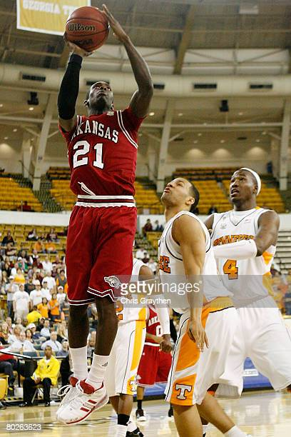 Patrick Beverley of the Arkansas Razorbacks makes a shot over Chris Lofton of the Tennessee Volunteers during the SEC Men's Basketball tournament on...