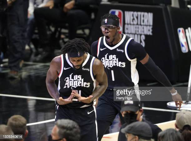 Patrick Beverley of the LA Clippers celebrates a three point basket with Reggie Jackson during the second half of game three of the Western...