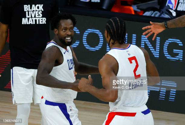 Patrick Beverley of the LA Clippers celebrates with Kawhi Leonard against the New Orleans Pelicans at HP Field House at ESPN Wide World Of Sports...