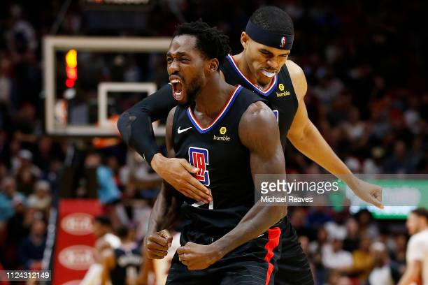 Patrick Beverley of the LA Clippers celebrates with Tobias Harris against the Miami Heat during the second half at American Airlines Arena on January...