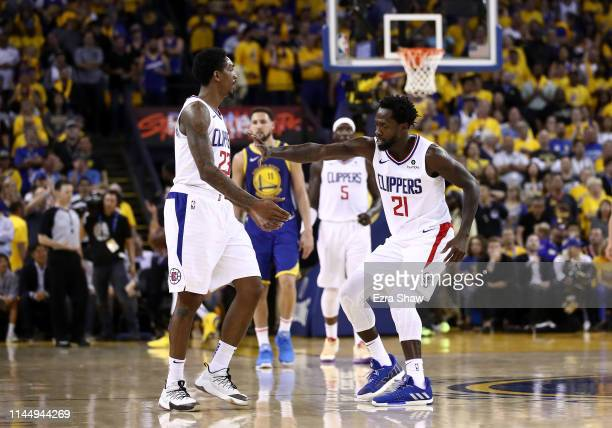 Patrick Beverley of the LA Clippers congratulates Lou Williams of the LA Clippers after he made a basket against the Golden State Warriors during...