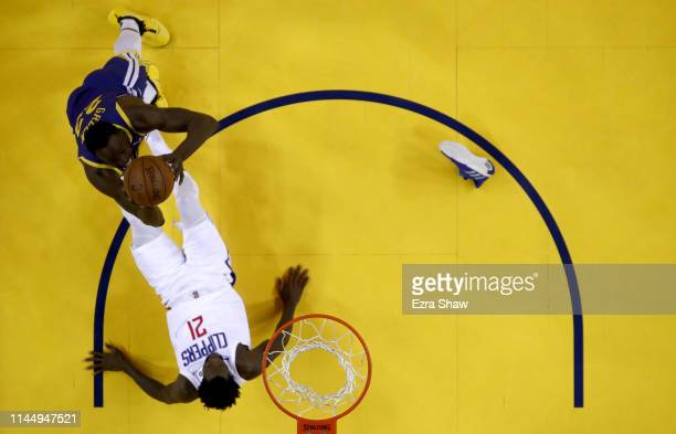 Patrick Beverley of the LA Clippers draws an offensive foul off of Draymond Green of the Golden State Warriors during Game Five of the first round of...