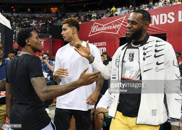 Patrick Beverley of the LA Clippers greets Kyle Kuzma and LeBron James of the Los Angeles Lakers before a game between the Lakers and the Clippers...