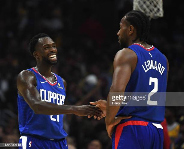 Patrick Beverley of the LA Clippers laughs with Kawhi Leonard leading the Los Angeles Lakers during the fourth quarter in a 112102 Clippers win in...