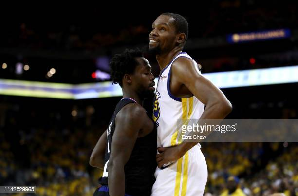 Patrick Beverley of the LA Clippers plays tight defense on Kevin Durant of the Golden State Warriors during Game One of the first round of the 2019...