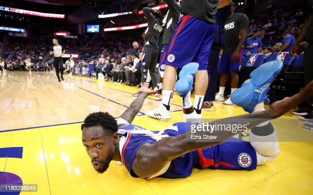 Patrick Beverley of the LA Clippers reacts after the Clippers made a dunk against the Golden State Warriors at Chase Center on October 24, 2019 in...