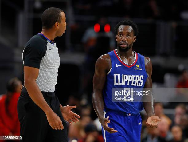 Patrick Beverley of the LA Clippers reacts to referee Phenizee Ransom after being charged with a technical foul against the Atlanta Hawks at State...