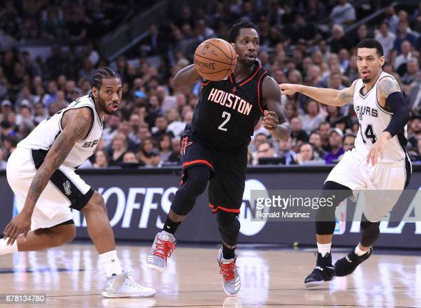 Patrick Beverley of the Houston Rockets drives between Danny Green and Kawhi Leonard of the San Antonio Spurs during Game Two of the NBA Western...