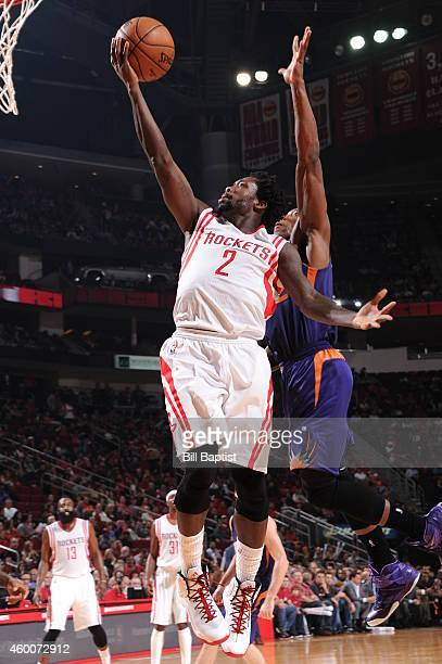 Patrick Beverley of the Houston Rockets goes up for a shot against the Phoenix Suns on December 6 2014 at Toyota Center in Houston Texas NOTE TO USER...