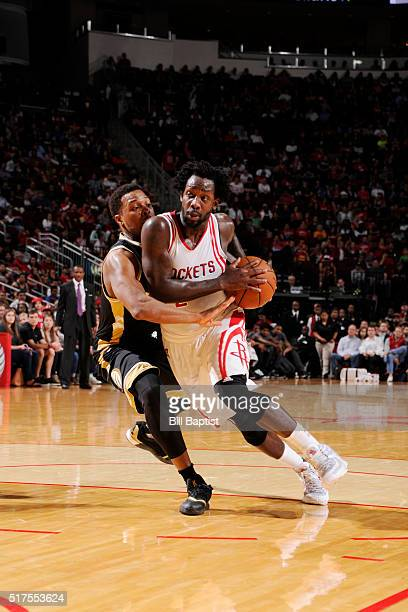 Patrick Beverley of the Houston Rockets handles the ball against Kyle Lowry of the Toronto Raptors on March 25 2016 at the Toyota Center in Houston...