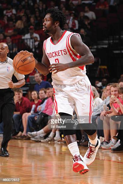 Patrick Beverley of the Houston Rockets handles the ball against the Phoenix Suns on December 6 2014 at Toyota Center in Houston Texas NOTE TO USER...